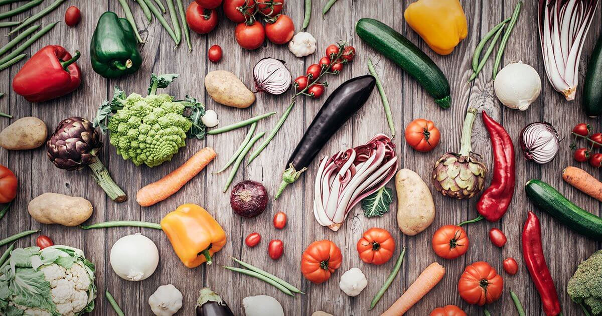 Assortment of vegetables on wooden table